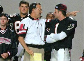 June Jones and Jeff George, depicted here September 1996, probably arguing over which would be booted out of Atlanta first.