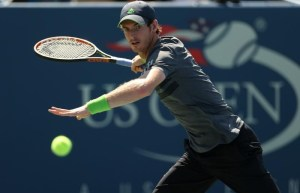 Andy Murray of Britain hits a return to Robin Haase of the Netherlands during their match at the 2014 U.S. Open tennis tournament in New York