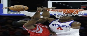 The 76ers' Nerlens Noel blocks a dunk attempt by Houston's James Harden. (Photo: Matt Slocum/AP )