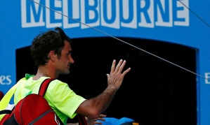 Roger Federer leaves Rod Laver Arena following his third-round defeat to Andreas Seppi